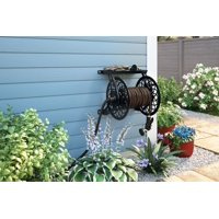 Suncast 125 ft. Slide Trak® Decorative Metal Wall Mount Garden Hose Reel with Shelf, Black